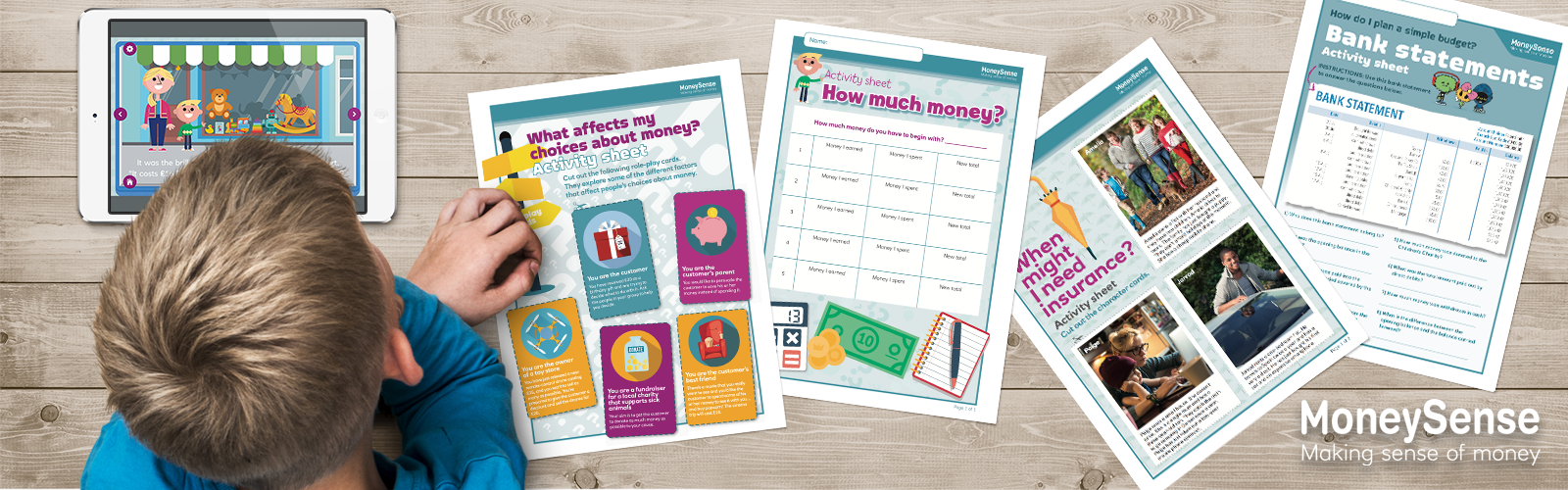 Child looking at a selection of brightly coloured MoneySense resources