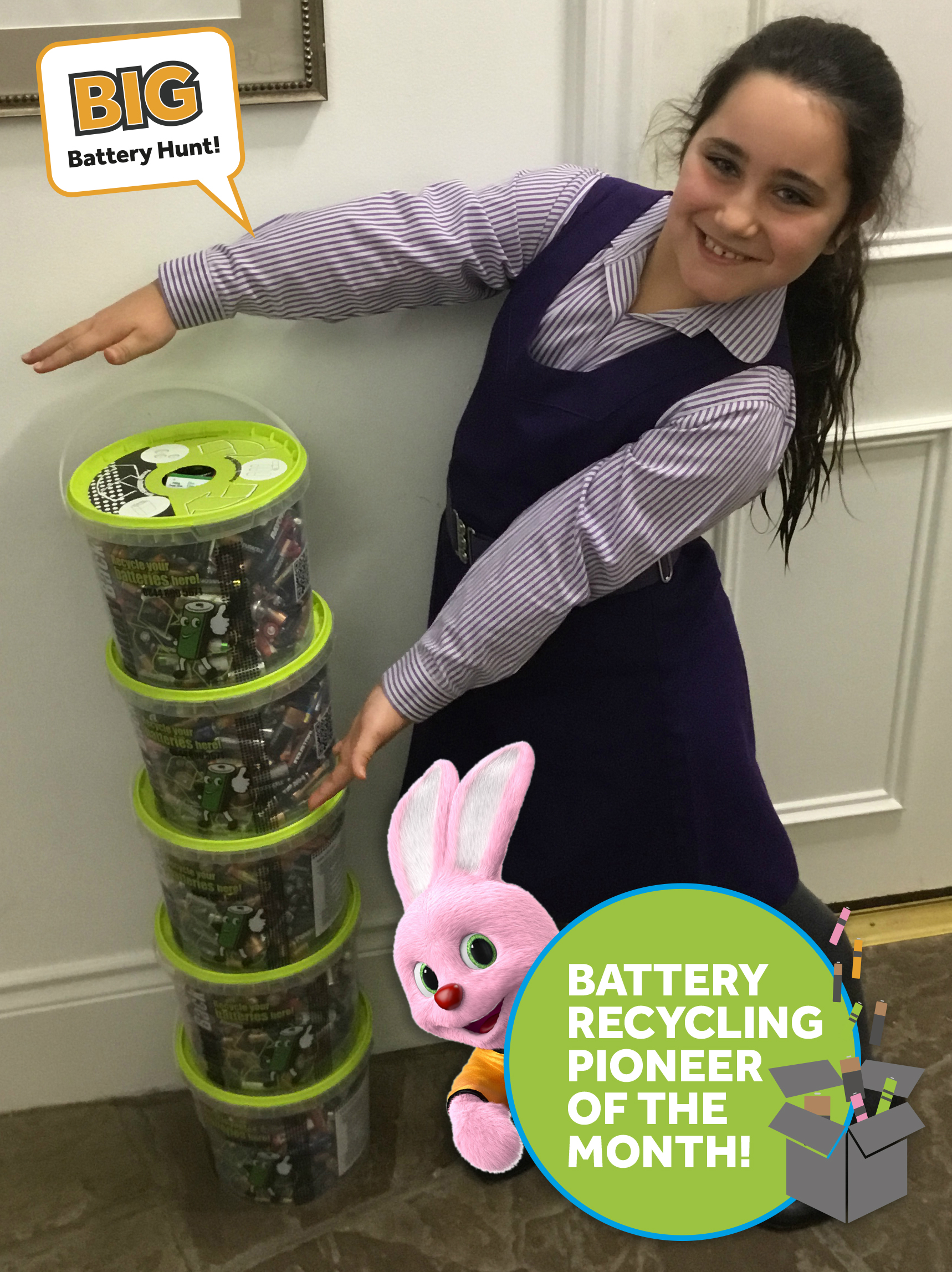 Talia showing off duracell battery bin collection